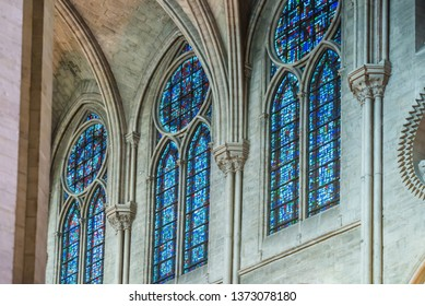 PARIS, FRANCE - SEPTEMBER 26, 2018 Beautiful vitrages stained glass windows in interior of cathedral Notre-Dame de Paris before fire April 15, 2019. Paris, France
