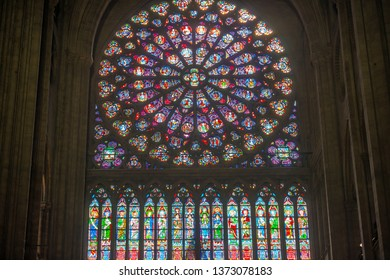 PARIS, FRANCE - SEPTEMBER 26, 2018 North Rose vitrages stained glass window in interior of cathedral Notre-Dame de Paris before fire April 15, 2019. Paris, France