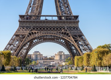PARIS, FRANCE - SEPTEMBER 27, 2018: Symmetrical look to the Eiffel Tower from the front in midday. View to one of the most visited touristic sites.Sunny day with no clouds