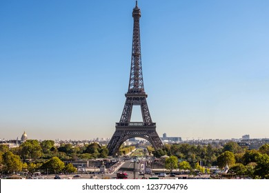 PARIS, FRANCE - SEPTEMBER 27, 2018: Symmetrical look to the Eiffel Tower from the front in midday. View to one of the most visited touristic sites. Sunny day with no clouds