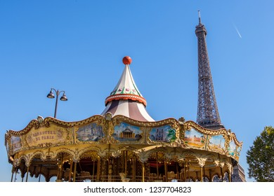 PARIS, FRANCE - SEPTEMBER 27, 2018: Carousel for kids far away from the Eiffel Tower. Entertainment for the little ones in the heart of country. Great day for playing outside