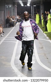 PARIS, FRANCE - SEPTEMBER 27: Designer Virgil Abloh and models walk the runway during the Off-White show as part of Paris Fashion Week Womenswear S/S 2019 on September 27, 2018 in Paris, France.