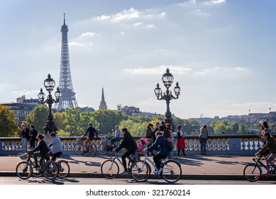 PARIS, FRANCE - SEPTEMBER 27: People on bicycles and pedestrians enjoying a car free day on Alexandre III bridge on September 27, 2015 in Paris, France
