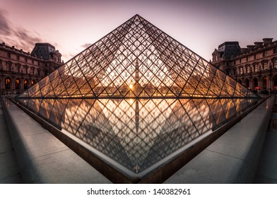 PARIS, FRANCE - SEPTEMBER 28: The Louvre Pyramid at dusk on September 28, 2012 in Paris. It serves as the main entrance to the Louvre Museum. Completed in 1989 and is a landmark of the city of Paris.