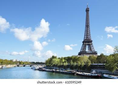 Paris, France - September 29, 2012 : Eiffel Tower distant landscape, river seine and boats