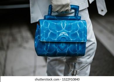 PARIS, FRANCE - SEPTEMBER 29, 2019: Fashionable woman holding bag after THOM BROWNE fashion show at Paris Fashion Week Spring/Summer 2020.