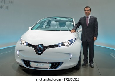 PARIS, FRANCE - SEPTEMBER 30, 2010 : CEO Renault Nissan Carlos Ghosn at the the Paris motor show at the side of the concept car Renault ZOE