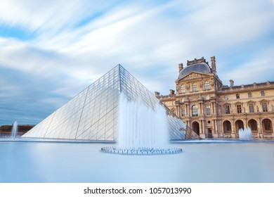 PARIS, FRANCE - September 30, 2017. View of famous Louvre Museum with Louvre Pyramid at evening. Louvre Museum is one of the largest and most visited museums worldwide. Long exposure photo.