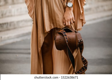 PARIS, FRANCE - SEPTEMBER 30, 2019: Fashionable woman holding  bag before STELLA McCARTNEY fashion show at Paris Fashion Week Spring/Summer 2020.