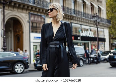 PARIS, FRANCE - SEPTEMBER 30, 2019: Linda Tol wearing black belted overall seen outside STELLA McCARTNEY show, during Paris Fashion Week Womenswear Spring/Summer 2020.