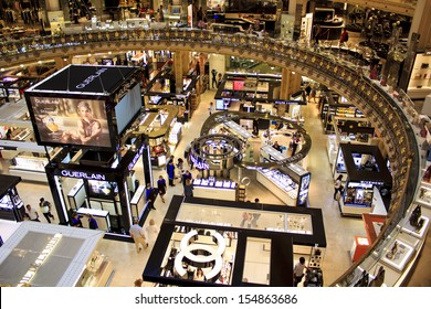 PARIS, FRANCE - SEPTEMBER 4 : inside part of the famous Galeries Lafayette with it's brand stands stalls such as Chanel and Lancome on September 4th 2013 in Paris, France