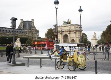 PARIS, FRANCE - SEPTEMBER 5 : French people biking bicycle rickshaw waiting travelers use service tour around paris at Musee du Louvre or the Grand Louvre Museum on September 5, 2017 in Paris, France