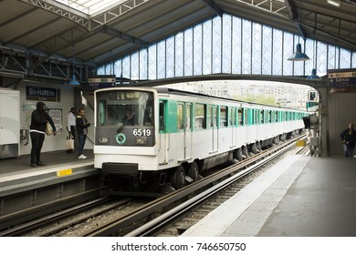 PARIS, FRANCE - SEPTEMBER 5 : French people and foreigner travlers walk and wait train at underground subway station of Paris Metro on September 5, 2017 in Paris, France