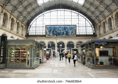PARIS, FRANCE - SEPTEMBER 5: French people and foreigner travlers walking and shopping at many shop inside of Gare de Paris-Est or Paris Gare de l'est station on September 7, 2017 in Paris, France