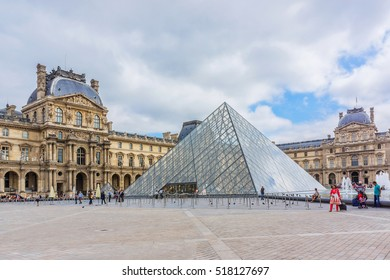 PARIS, FRANCE - SEPTEMBER 6, 2016: View of pyramid and fountain at courtyard of Louvre Museum. Louvre Museum is one of the largest and most visited museums worldwide.