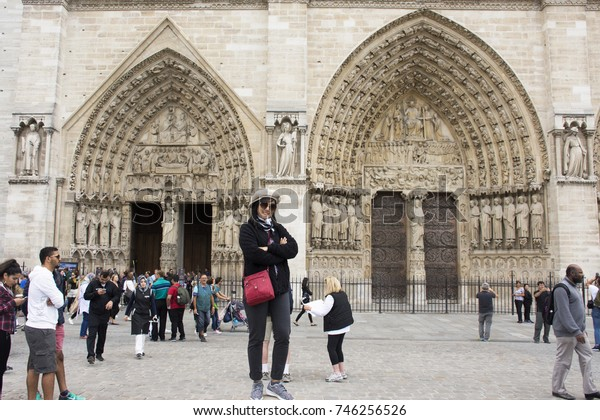 PARIS, FRANCE - SEPTEMBER 6 : Asian thai woman travel and posing for take photo at courtyard of Cathedrale Notre-Dame de Paris on September 6, 2017 in Paris, France