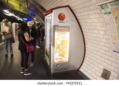 PARIS, FRANCE - SEPTEMBER 6 : Foreigner travlers asian women buying food and drink from Automatic vending machine at underground subway station of Paris Metro on September 6, 2017 in Paris, France