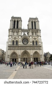 PARIS, FRANCE - SEPTEMBER 6: French people and foreigner travlers walking visit and take photo at courtyard of Cathedrale Notre-Dame de Paris or Our Lady of Paris on September 6, 2017 in Paris, France