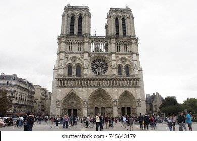 PARIS, FRANCE - SEPTEMBER 6 : French people and foreigner travlers walking visit and take photo at courtyard of Cathedrale Notre-Dame de Paris on September 6, 2017 in Paris, France