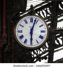 PARIS / FRANCE - SEPTEMBER 6th, 2010: Platform clock at Gare de Lyon (train station). Blue fingers and numbers on white clock face. Inscription: Bodet. Time on clock: 06h03