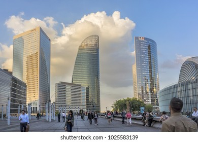 PARIS, FRANCE - SEPTEMBER 7, 2016: Skyscrapers in business district of Defense to west of Paris at sunset. Defense is biggest business district in France.