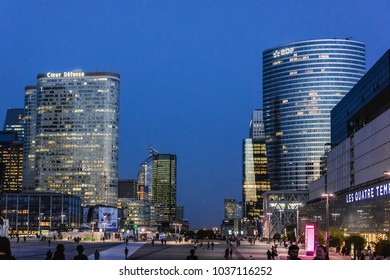 PARIS, FRANCE - SEPTEMBER 7, 2016: Skyscrapers in business district of Defense to west of Paris at night. Defense is biggest business district in France.