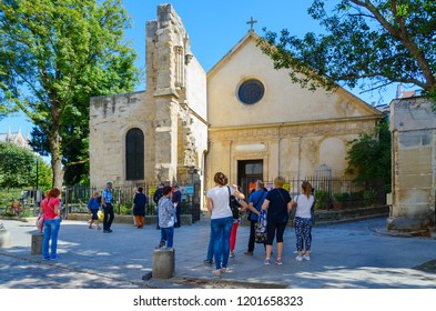 PARIS, FRANCE - SEPTEMBER 7, 2018: Group of unknown tourists is in front of old Church of Saint-Julien-le-Pauvre in Latin Quarter, Paris, France