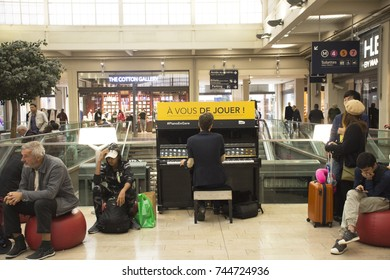 PARIS, FRANCE - SEPTEMBER 7 : French man playing piano for show French people  and foreigner travlers at Gare de Paris-Est or Paris Gare de l'est railway station on September 7, 2017 in Paris, France