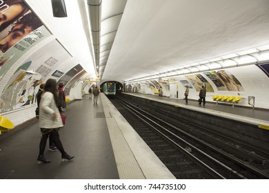 PARIS, FRANCE - SEPTEMBER 7 : French people and foreigner travlers walk and wait train at underground subway station of Paris Metro on September 7, 2017 in Paris, France