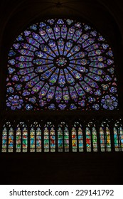 Paris, France - September 9, 2014: Paris, Notre Dame Cathedral. North transept rose window. The Glorification of the Virgin Mary