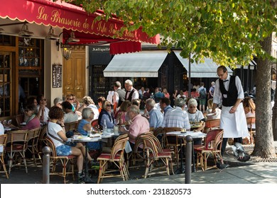Paris, France - September 9, 2014: : People visit Brasserie de l'Isle Saint-Louis on September 9 2014 in Paris. This is the typical Parisian cafe