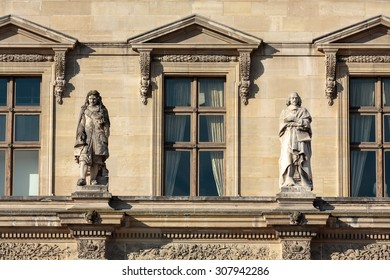 PARIS, FRANCE - SEPTEMBER 9, 2014: Paris -  Architectural fragments of Louvre building. Louvre Museum is one of the largest and most visited museums worldwide.