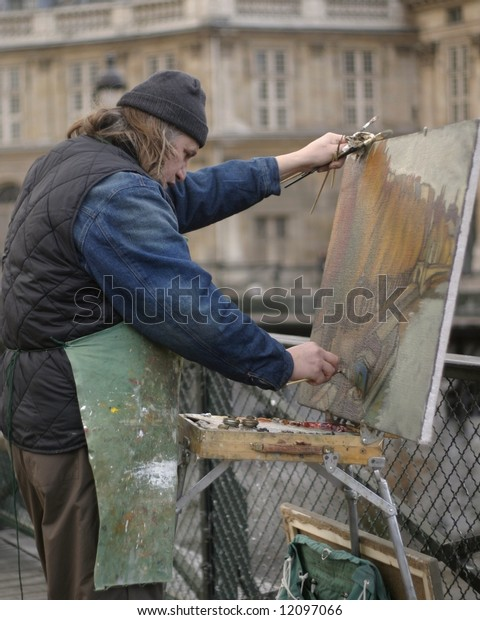 Paris, France street artist painting Seine River