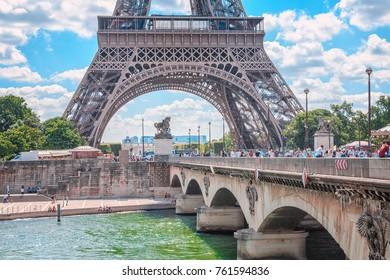 Paris, France. View at Eiffel tower over Seine river and bridge d'Lena.
