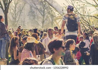 Paris, France-03.31.2019: Holi Festival Of Colors in Jardin d'Acclimatation Paris.  People painted with colored dust.