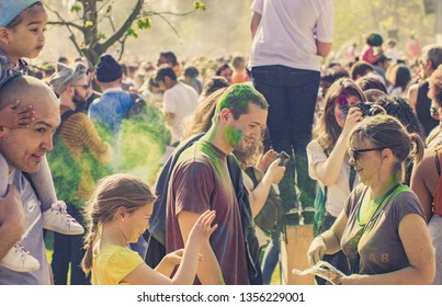 Paris, France-03.31.2019: Holi Festival Of Colors in Jardin d'Acclimatation Paris.  People painted with colored dust.