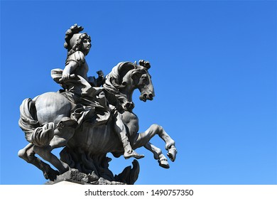 Paris, France-06 17 2019: The Equestrian statue of Louis XIV in the courtyard of the Louvre Museum is a bronze replica of an original marble statue sculpted by Gian Lorenzo Bernini in 1677.