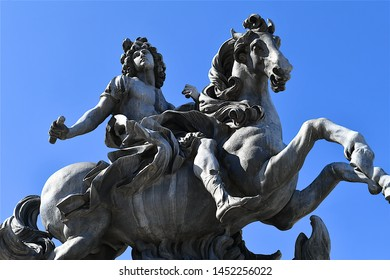 Paris, France-06 17 2019:Equestrian statue of Louis XIV in the courtyard of the Louvre Museum in Paris, France.This is a bronze replica of an original marble statue sculpted by Gian L.Bernini in 1677.
