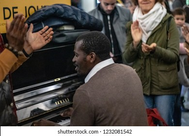 Paris, France-11.16.2018: Men singing gospel music at piano attract a crowd in Saint Lazare Station. Man singing at the piano.