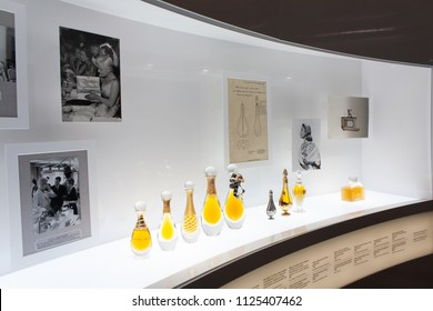 Paris, France/27 August 2018-Some old Christian Dior perfume bottles presented in the exhibition `Christian Dior: Designer of Dreams`, part of the Christian Dior history