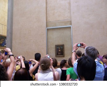 Paris, France-August 05, 2009: Tourists take pictures the Mona Lisa (Monna Lisa or La Gioconda in Italian and La Joconde in French) painting at the Louvre Museum