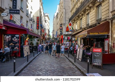 Paris, France-August 18, 2018: a street on the left bank in the Latin Quarter of Paris, France with shops, restaurants and tourists