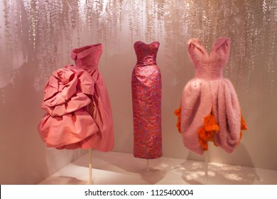 Paris, France/August 27 2017-Three Dior gowns exhibited at the Museum of Decorative Arts in Paris. The exhibition was named `Christian Dior: Designer of Dreams`
