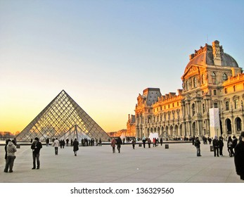 PARIS, FRANCE-DEC. 24: The kings palace louvre with its famous pyramid on December 24, 2012. Louvre is the biggest Museum in Paris displayed over 60,000 sq.M. of exhibition space.