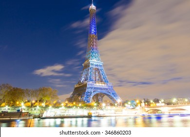 Paris; France-december 02, 2015 : The Eiffel tower lit up in honor of conference on climate change COP21 that gathers 193 countries in Paris, France.