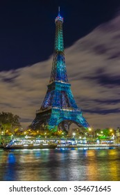 Paris; France-December 02; 2015: The Eiffel tower lit up in green as a part of the organization of of the conference on climate change COP 21.this conference gathers 193 countries in Paris.