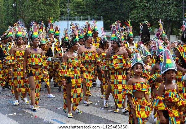 Paris, France-July 01, 2018 :The participants of Tropical carnival 2018 in Paris . Over 4,000 dancers and a dozen floats from around the world participate in the parade through the Champs-Elysees