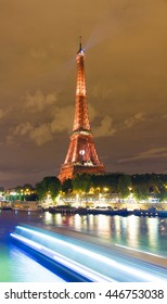 paris; France-July 03, 2016 : The Eiffel tower lit up in red color for  soccer Europe championship 2016  in France. The Eiffel tower is on of the most visited monuments in the world.