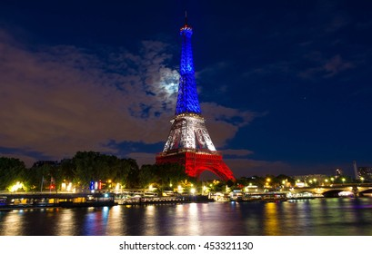 Paris, France-July 16, 2016 : The Eiffel tower lit up with colors of French national flag to honor the victims of July 14, 2016 terrorist's attack in Nice.