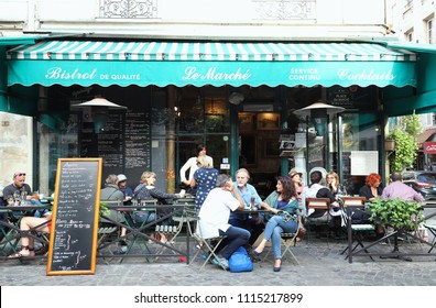 Paris, France-June 16, 2018 : View of typical French bistrot Le Marche in the quarter Marais, the historic Parisian district set on the Right Bank .
